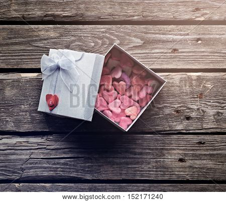 Open gift box with lots of cute little hearts inside.