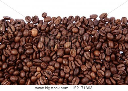 Closeup of coffee beans on plain background