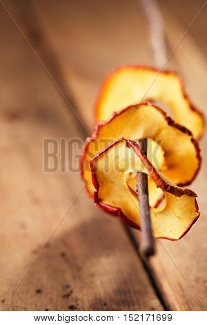 Dried apple slices and wooden backdrop