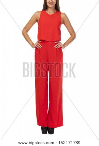 Young beautiful happy brunette woman in red pantsuit, isolated on white background