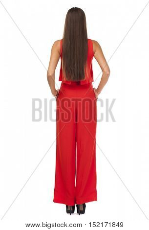 Back view. Young beautiful brunette woman in red pantsuit, isolated on white background