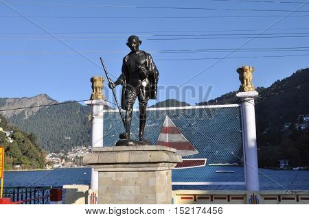 November 11, 2015: Statue of Mahatma Gandhi Father of the Nation at Bus stand area, Tallital, Nainital, Uttarakhand, India. Nainital is a popular hill station in Uttarakhand, named after the Goddess Naina Devi. It also known as the 'Gateway to Kumaon Hima