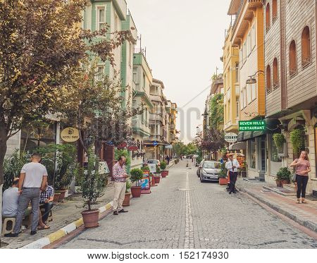 Fatih Istanbul Turkey - September 10 2016: Tourist street full of colorful hotels.