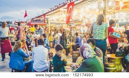 Fatih Istanbul Turkey - September 12 2016: Fish market full of people and small restaurants.