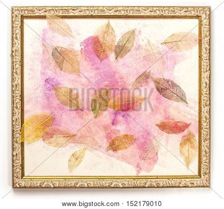 Photo of a frame with an abstract pink painting, with skeleton leaves scattered around it. The concept of delicate nature, with copyspace
