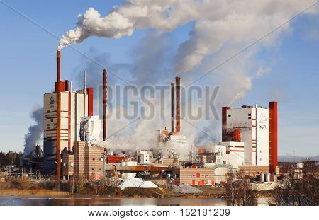 Timra, Sverige - November 8, 2013: Ostrand pulp mill a factory in the forest products group SCA.