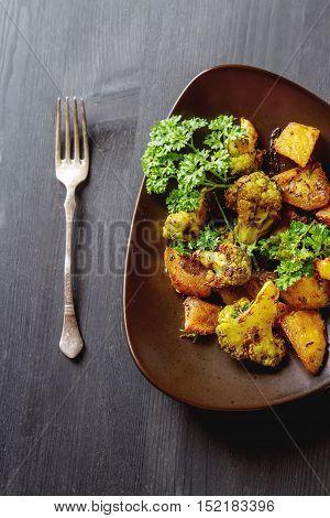 Traditional Indian Aloo Gobi Fish With Potato, Cauliflower And S