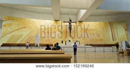 FATIMA, PORTUGAL - October 6, 2016: Panel made of terracotta gilt and molded manually of the presbytery of the Most Holy Trinity Basilica in Fatima Portugal.