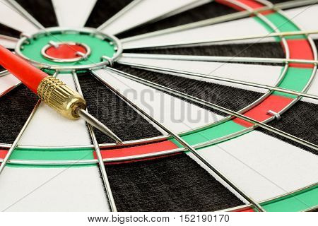 close up of dart board with a dart on it