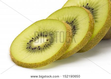 Close-up of sliced kiwifruit on white isolated background