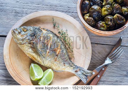 Grilled Dorade Royale Fish With Fresh And Baked Vegetables