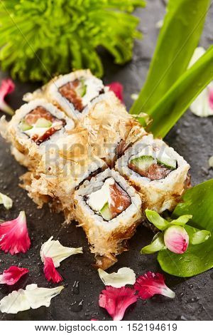 Bonito Maki Sushi - Rolls with Fresh Salmon, Cucumber and Cream Cheese inside. Dried Shaved Bonito outside