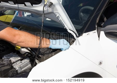 Hands Of Man Car Mechanician Repairs Car