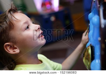 Child At Amusement Park