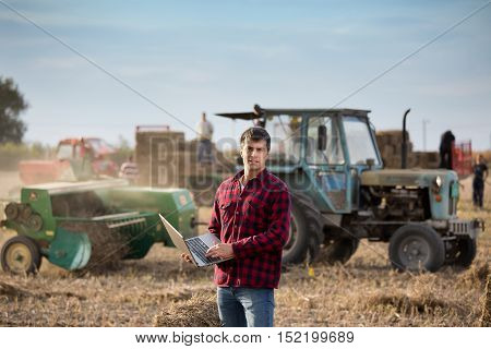 Farmer With Soybean Bale