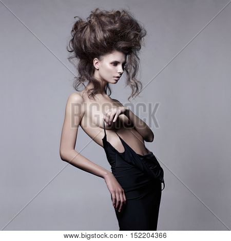 Studio fashion portrait of beautiful sensual woman with volume wavy hair. Big hair poster