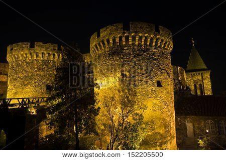 Fortress tower, gate and wooden bridge at night, Kalemegdan, Belgrade, Serbia
