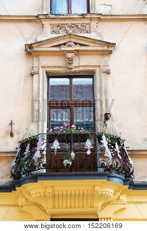 old balcony with flowers. balcony over the cracks and modeling