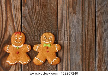 Christmas homemade gingerbread cookies on wooden background