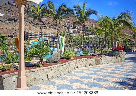 TAURITO, GRAN CANARIA, SPAIN - APRIL 20, 2016: Promenade to the beach in Taurito, Gran Canaria. Taurito