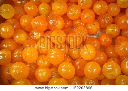 The texture of ripe fruit orange kumquat close up.
