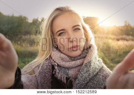 fun girl taking selfie with duckface at sunset time