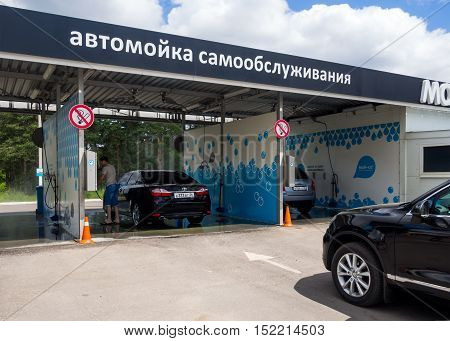 Voronezh, Russia - June 20, 2016: The car is waiting queue for the self-service car wash Voronezh