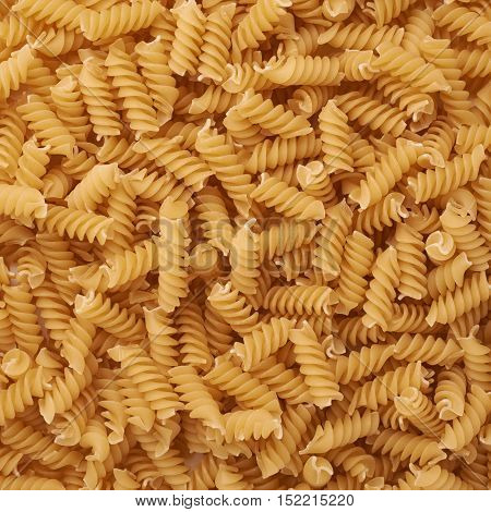 Pile of dry rotini yellow pasta as abstract background