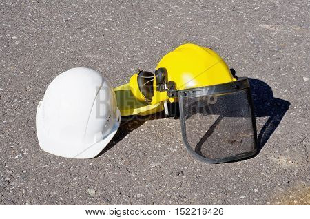 Yellow And White Construction Helmets