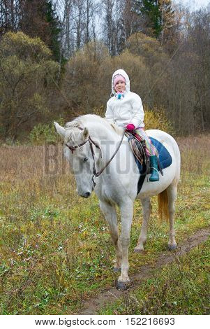 Girl Riding On A White Horse