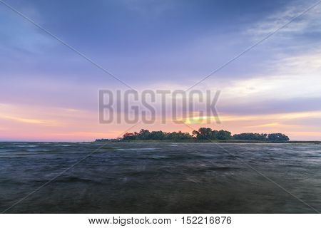 hardwood island on background sunrise / colorful landscape Ukraine wilderness