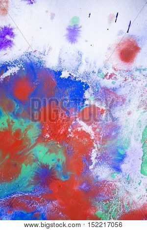 red and blue blurred ink stains on white paper