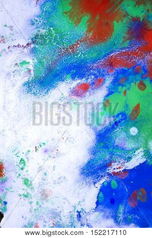 red and blue, the green blurry wet paint stains on white paper