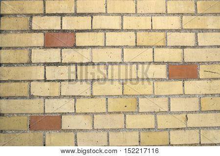 Background yellow brick wall with three brown bricks