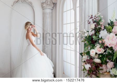 Charming young bride in luxurious wedding dress. Pretty girl, photo Studio