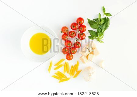 Italian red tomatoes close up food with pasta, basil leafs, cheese, isolated on white background - Flat lay