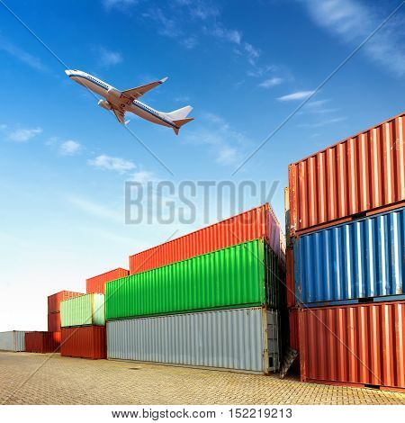 The plane flew over the container yard.