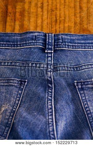 blue jean or blue denim on wooden, part of blue jean or blue denim, back of jean or denim