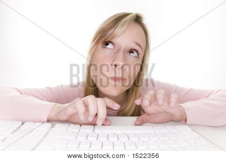 Teenage Girl Thinking Using Computer
