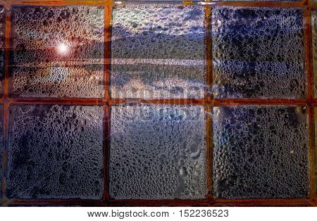 Abstract photography window with rain on a lake sunset