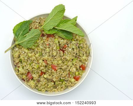 Tabbouleh (also known as Tabouleh, Tabouli and Taboulee): A traditional Cracked Wheat salad popular in Mediterranean cuisine.