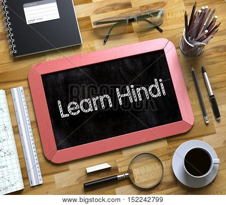 Learn Hindi - Text on Small Chalkboard.Top View of Office Desk with Stationery and Red Small Chalkboard with Business Concept - Learn Hindi. 3d Rendering.