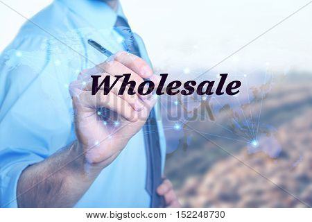 Wholesale concept. Young man on blurred background