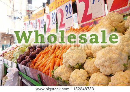 Wholesale concept. Vegetables stalls in market