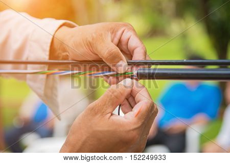 Technicians are installing optic fiber,cable ties with cable tie.