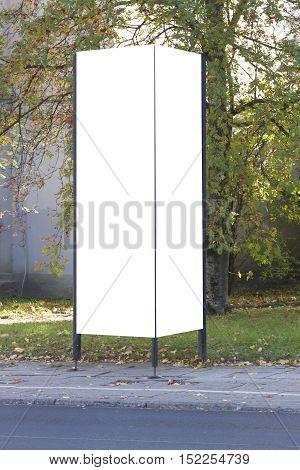Street advertising or information column stand on sidewalk. Mockup
