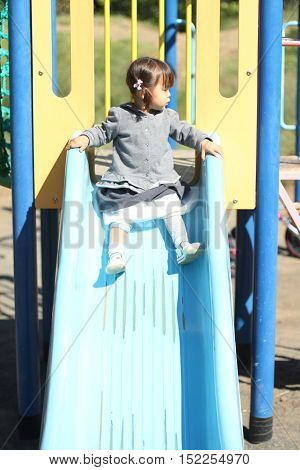 Japanese girl on the slide (1 year old)