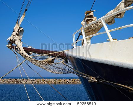 Bowsprit and gathered sail of a large classical traditional vintage tall sailing ship