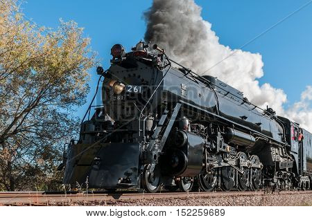 CHANHASSEN MN - OCTOBER 9,2016: The Milwaukee Road #261 steam engine pulls on its annual Fall Colors Tour from Minneapolis MN to Winthrop MN. This line has not had regular passenger trains traffic since 1960.