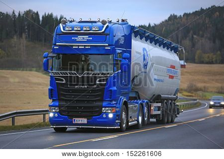 SALO, FINLAND - OCTOBER 15, 2016: Blue Scania R620 truck of Scandinavian Finbulk and jumbo semi tank trailer of 91 cubic meters for transporting extra light materials on the road in South of Finland.